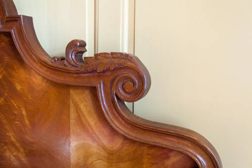 Carved Mahogany bed headboard detail
