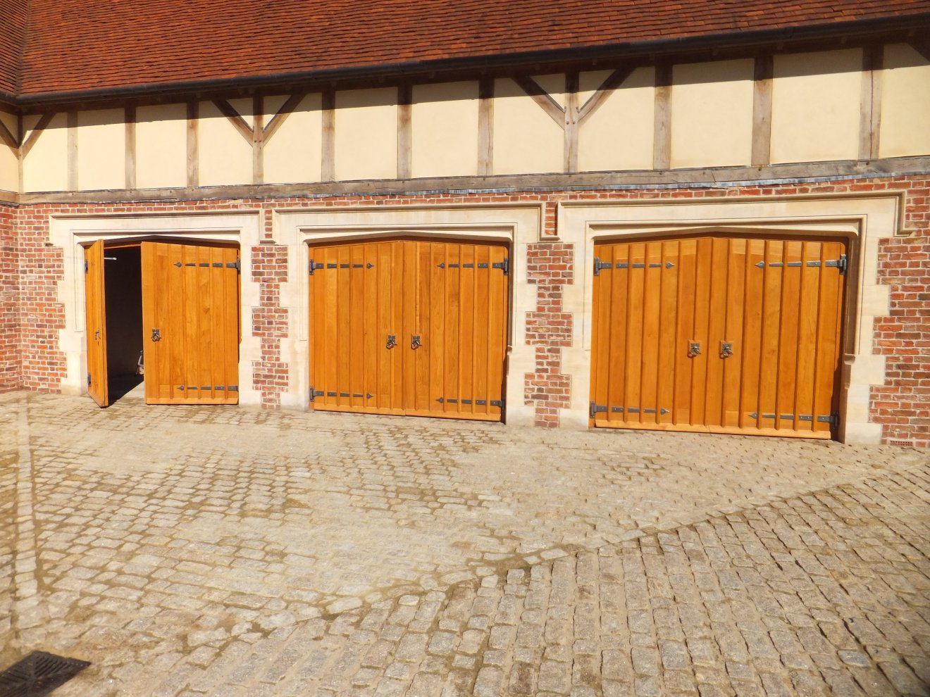 Gothic Style Garage Doors In Solid Oak Complete With Handmade Ironwork