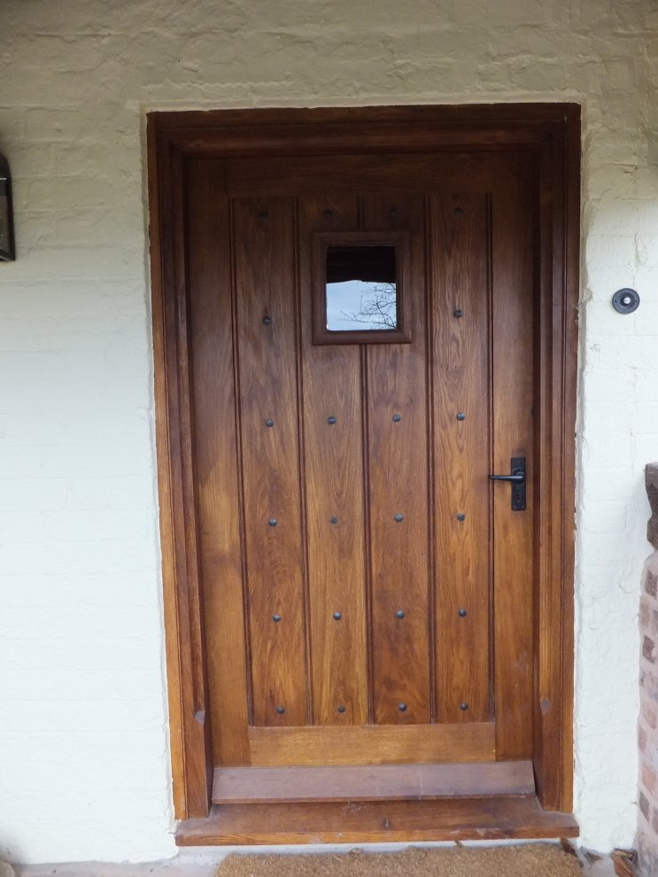 Solid Oak Door With Heavy Door Frame And Handmade Ironwork