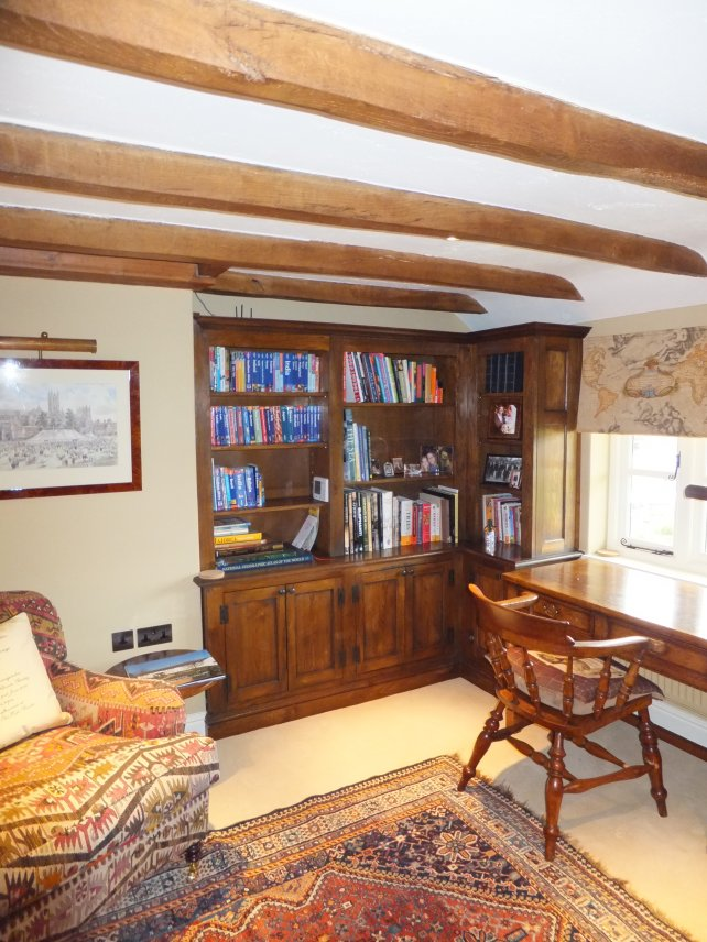 Bookcase in a snug with beamed ceiling