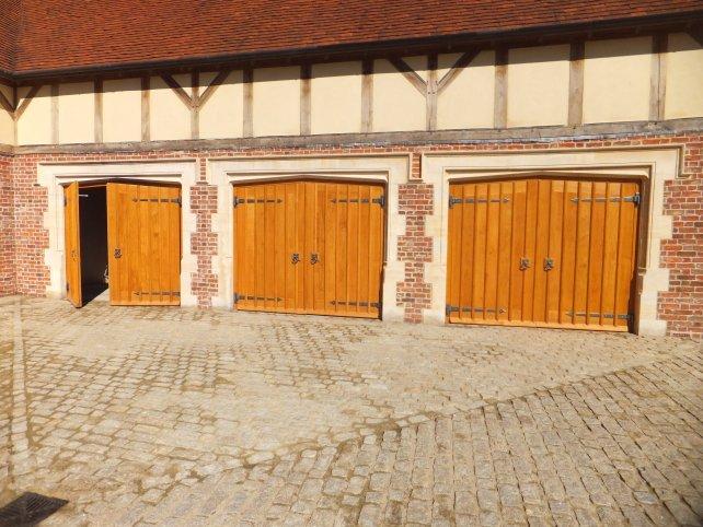 gothic style garage doors with handmade ironwork