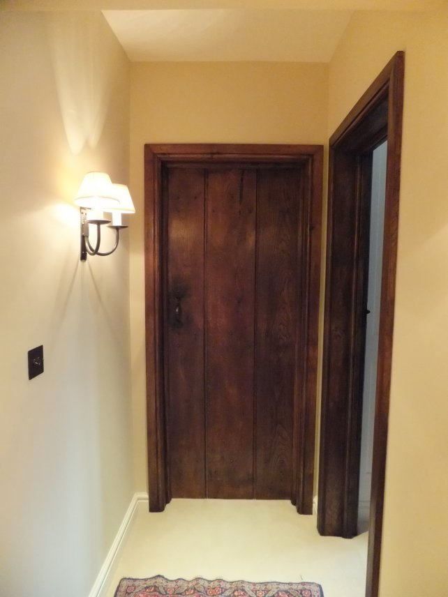 solid oak planked door complete with door lining, architrave and handmade ironwork