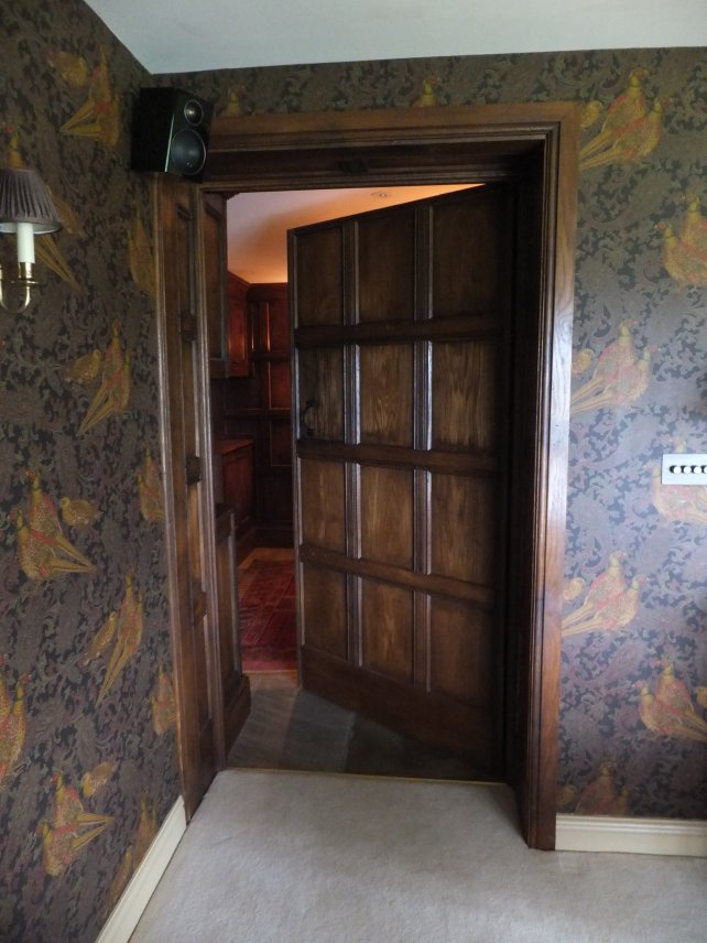 wide oak panelled door