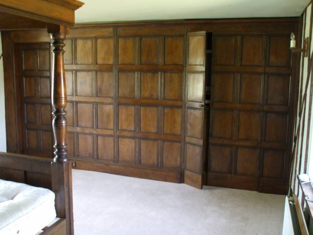 16th century oak room panelling with secret door