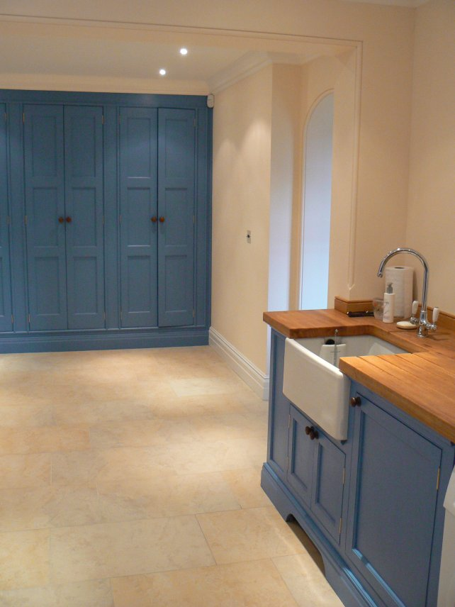 painted utility kitchen with larder unit and Belfast sink, wooden worktops