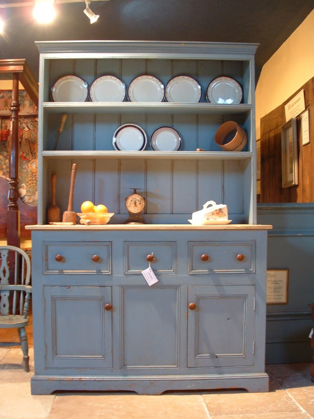 dresser with a distressed painted finish