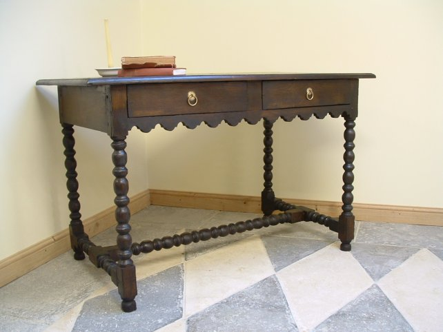 side table with scalloped detailing and hand carved legs and stretcher