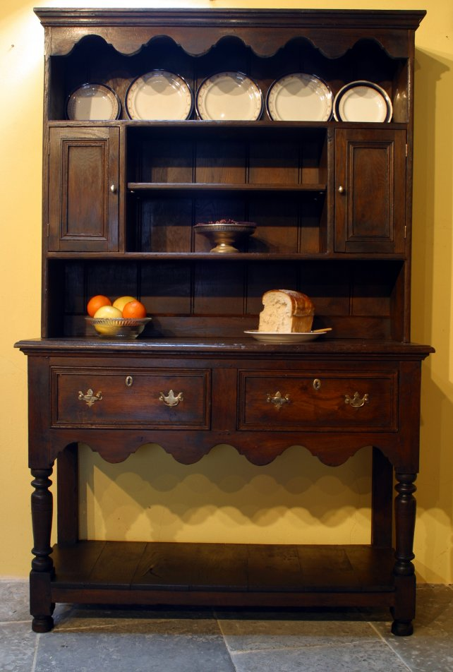 dresser and rack with shaped apron and pot boarded base