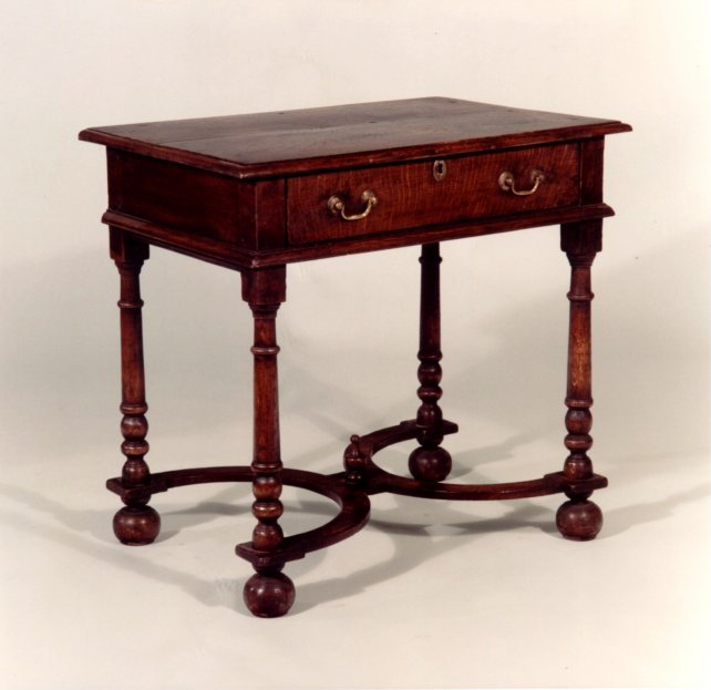 18th century oak side table with platform stretcher and bun feet