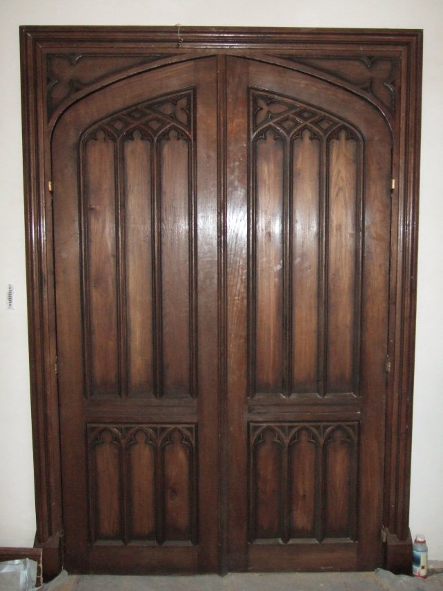 a pair of oak gothic doors, aged and polished