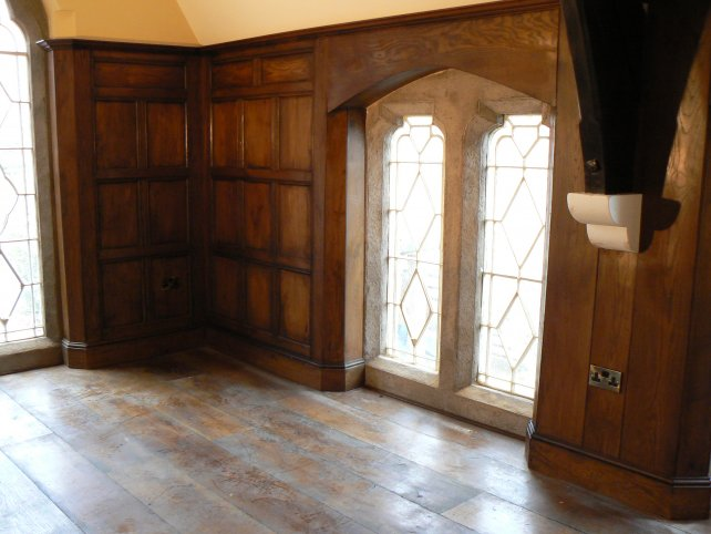 period oak panelled room with oak flooring