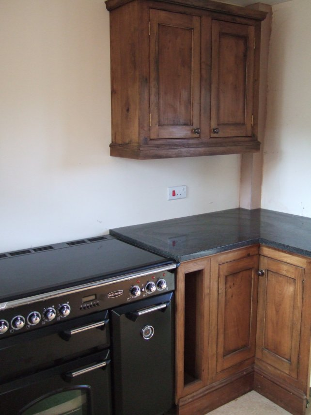 oak kitchen with fielded panels and granite worktop
