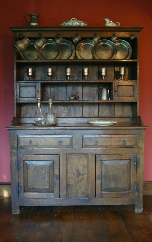 period dresser and rack with fielded panels on doors and drawers