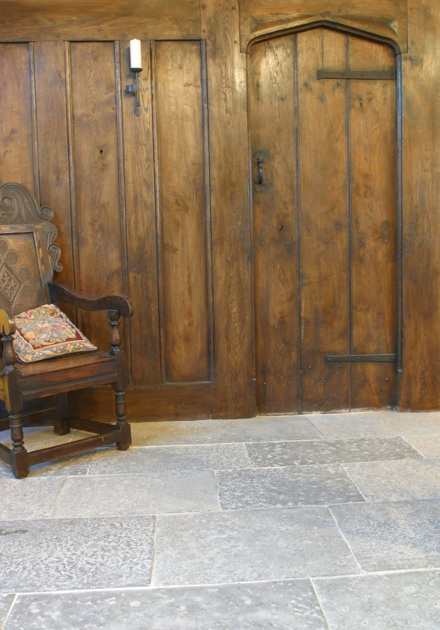 period plank and muntin screen with solid oak planked door