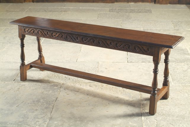 jointed bench with carved rails