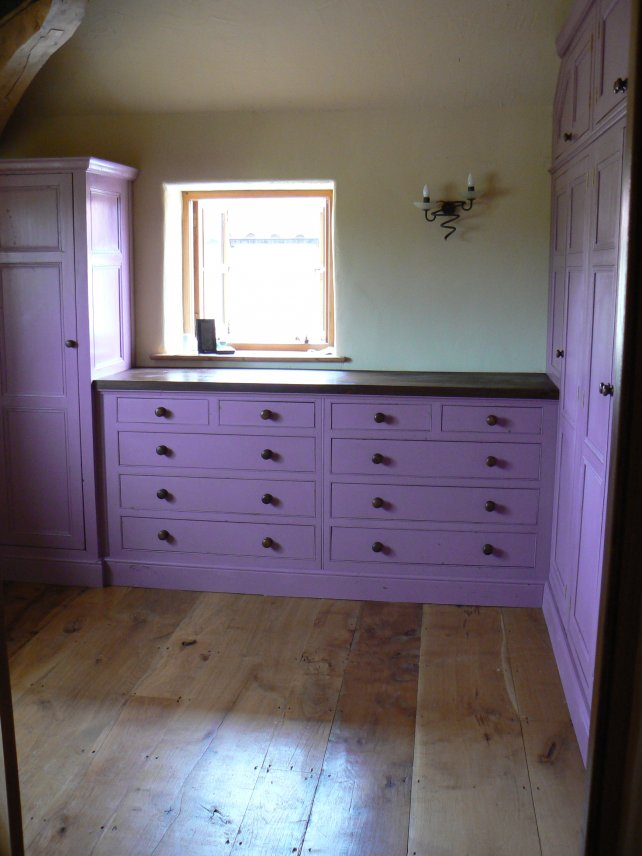 painted dressing room incorporating chest of drawers and wardrobes