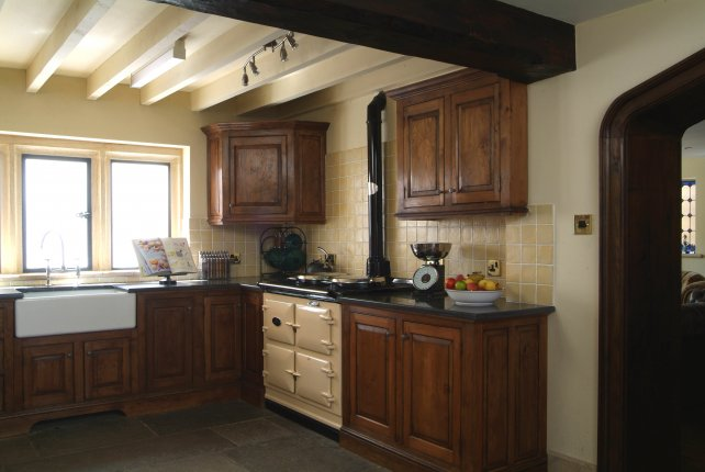 oak kitchen with Aga and flagstone floor