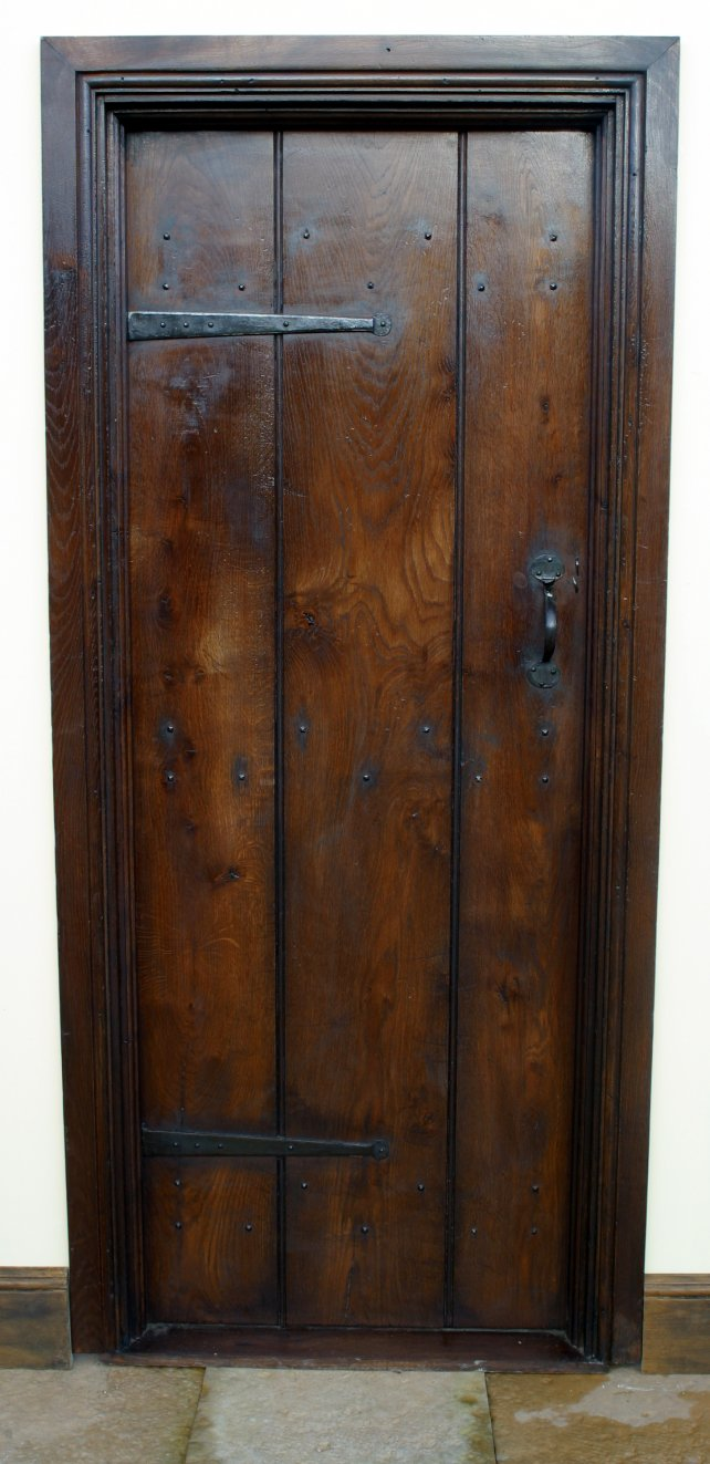 period planked door with door lining and architrave