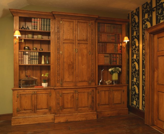 Solid oak break fronted bookcase with hand carved pilasters
