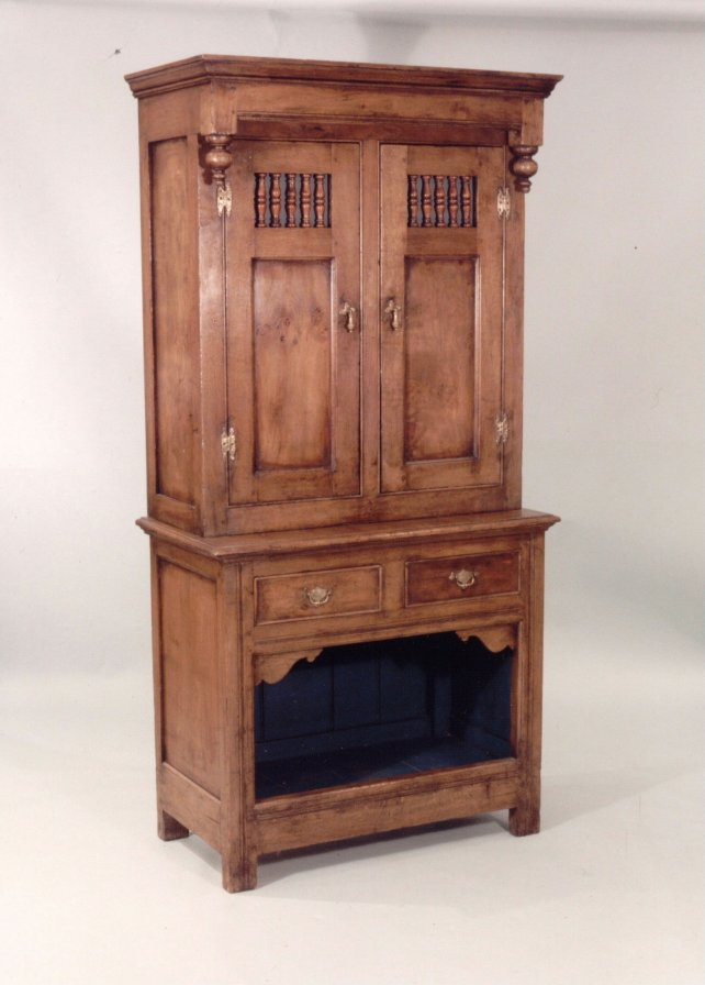 dresser with dog kennel base and drop finials