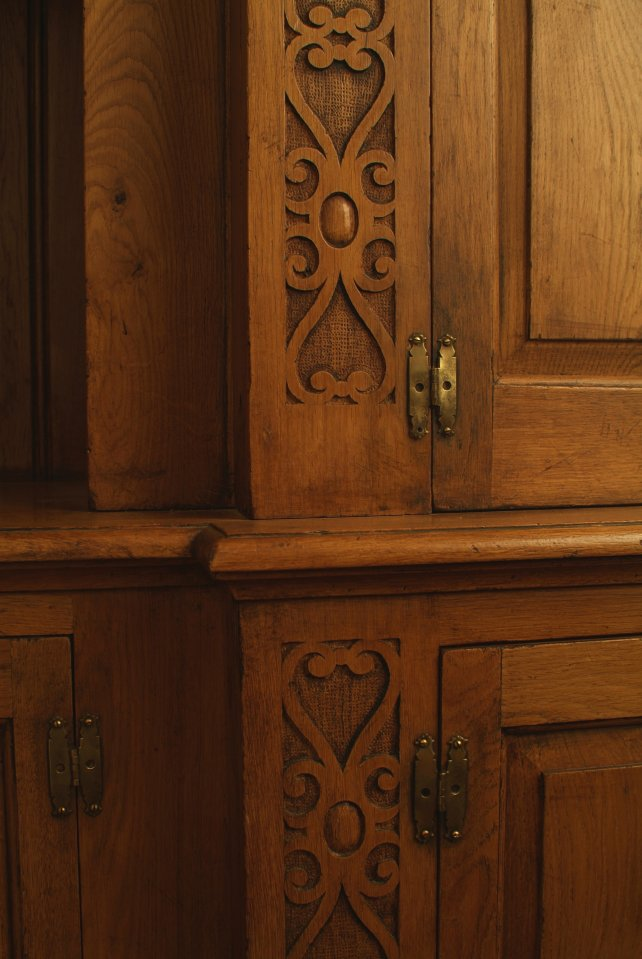 Carved pilasters with fielded door panels