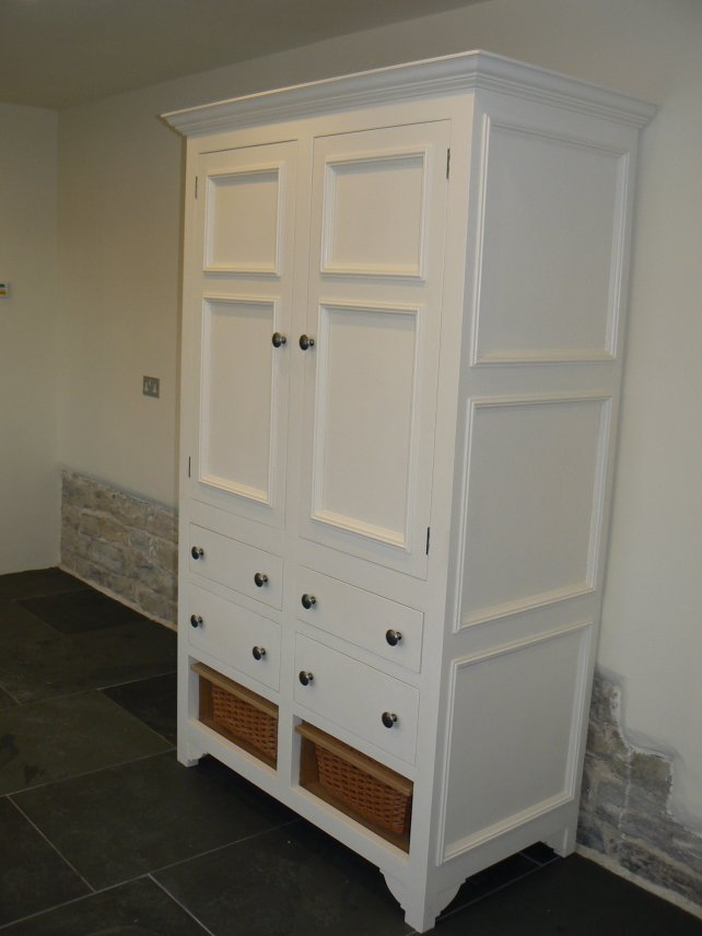 painted cooks cupboard with wicker baskets at the bottom