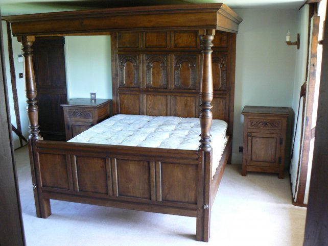 four poster bed with hand carved panels complete with matching bedside cabinets