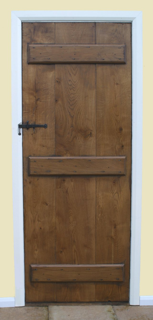 reverse side of our oak planked door showing the ledges