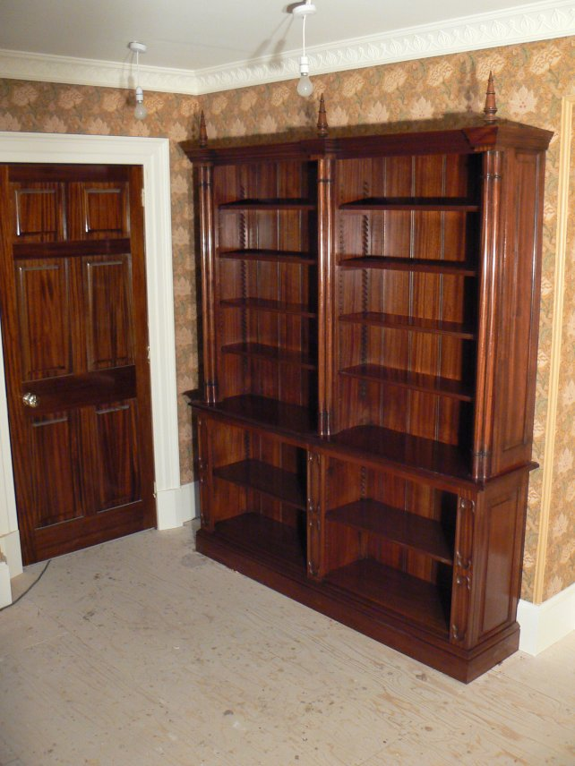 Mahogany bookcase with mahogany fielded panel doors in a country house