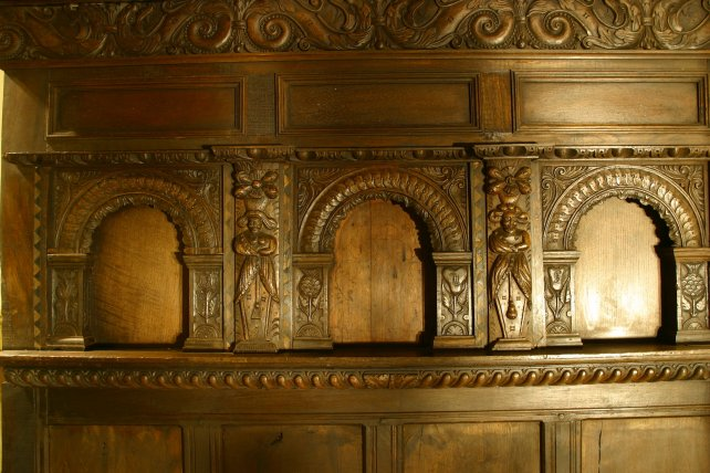 detailing of heavily carved panels and frieze of our four poster bed
