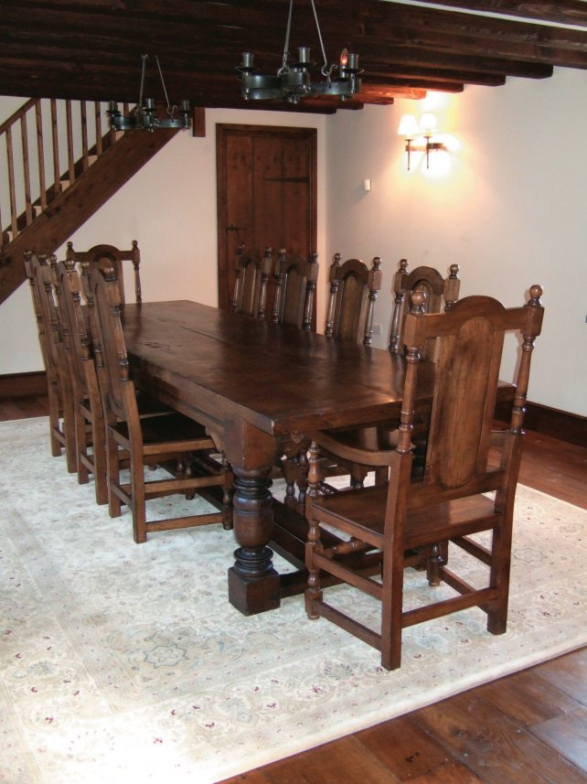dining room set comprising of a refectory table with simple channel moulding and panel back carvers and side chairs