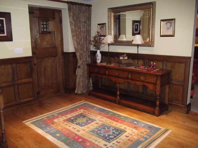 tudor style oak panelling with oak low dresser with shaped apron