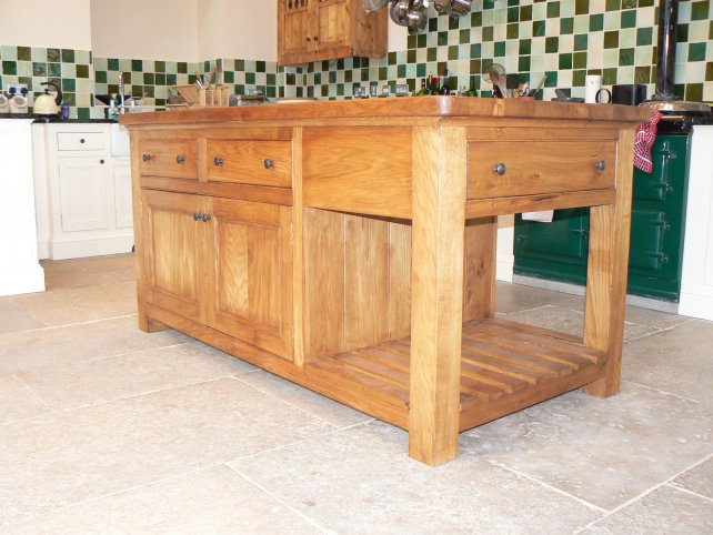 solid oak island unit with drawers and open rack