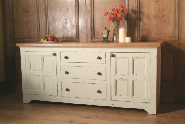 painted sideboard with oak worktop and moulded doors with an aged and painted finish