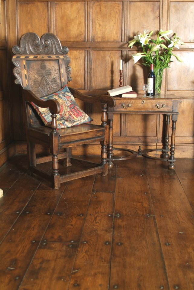 wainscot chair with carved inlay and 18th century side table with platform stretcher bun feet
