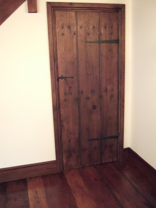 planked door with handmade T hinges and latch