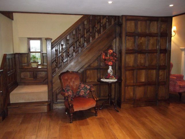 oak panelling and staircase with hand turned spindles