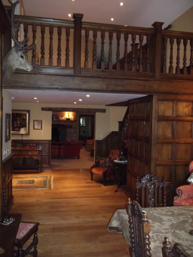 oak 16th century panelling with gallery landing, hand turned balusters