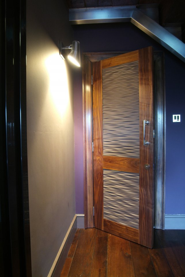 bespoke walnut door with wavy MDF panels