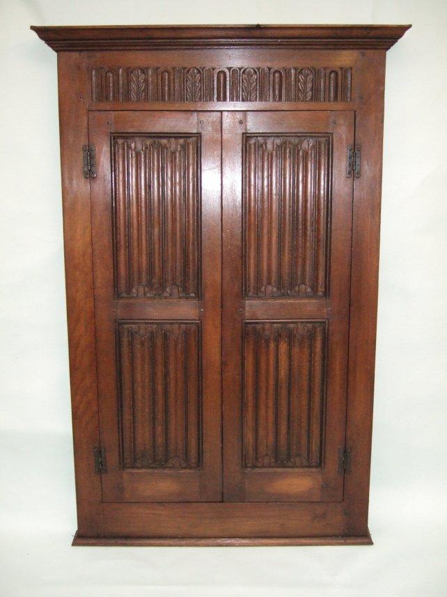 oak cupboard with linenfold panels