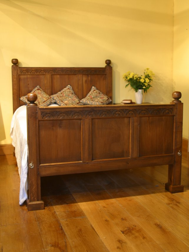 half headed bed in solid oak, aged and polished