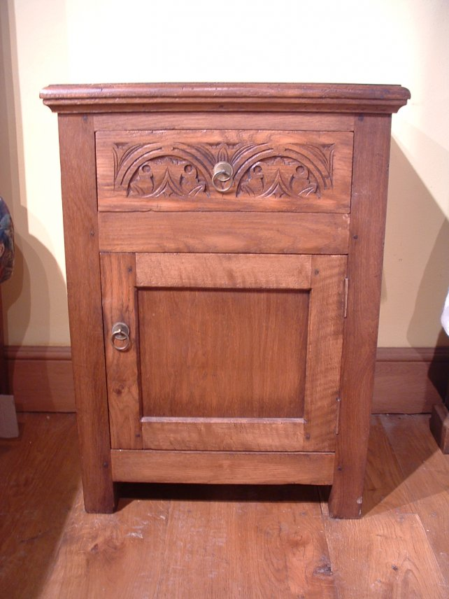 bedside cabinet in oak with hand carved drawer front