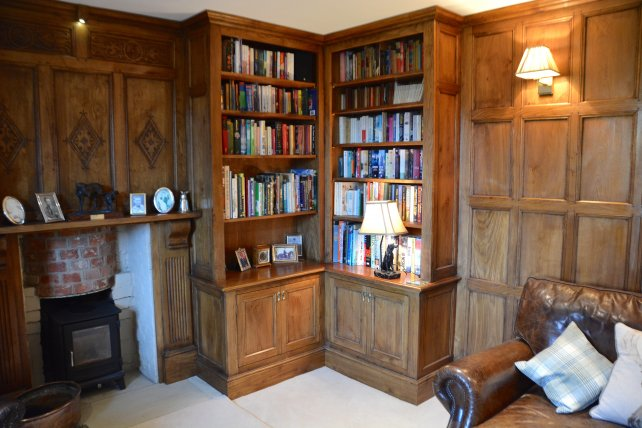Fitted study/TV room with oak bookcases, overmantel and 17th century panelled room