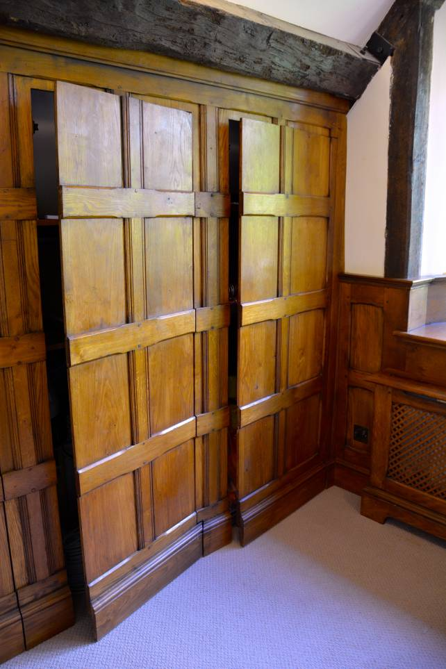 oak cupboard with secret panelled doors