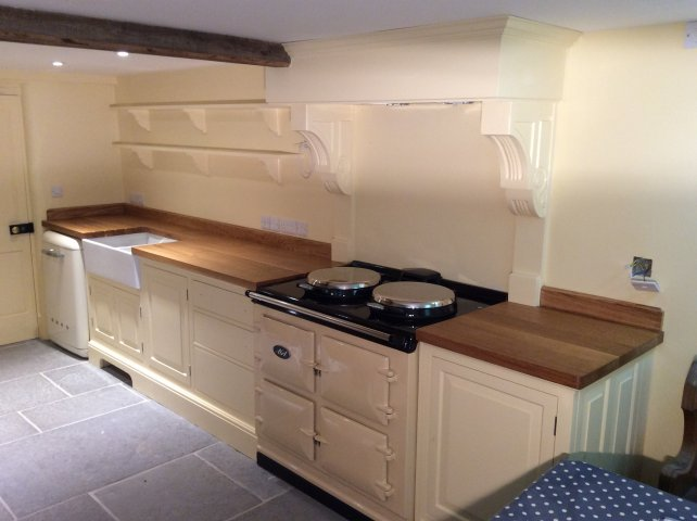 painted kitchen with wooden work top with Aga and Smeg appliances