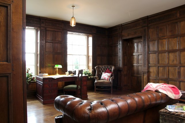 stuart style panelled room with hand carved frieze