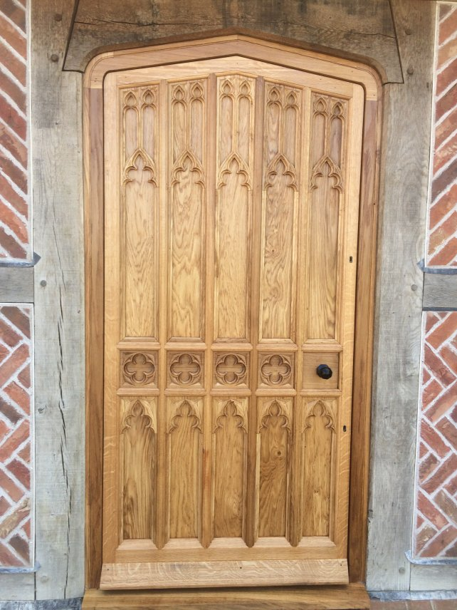 gothic front door with hand carved tracery panels in solid oak