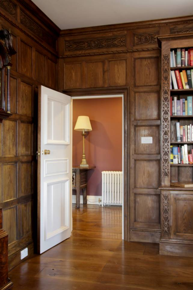 2 panelled painted door within a full panelled room