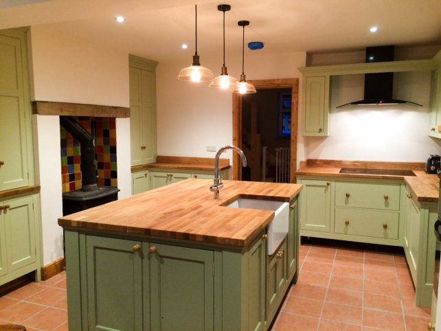 painted kitchen with freestanding island unit with belfast sink
