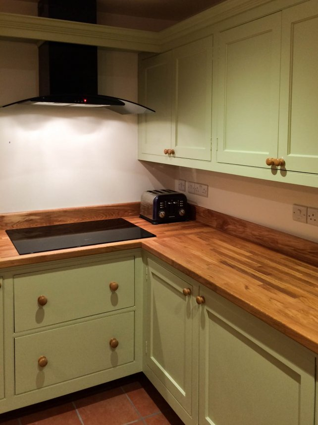 painted kitchen with deep pan drawers and oak work top